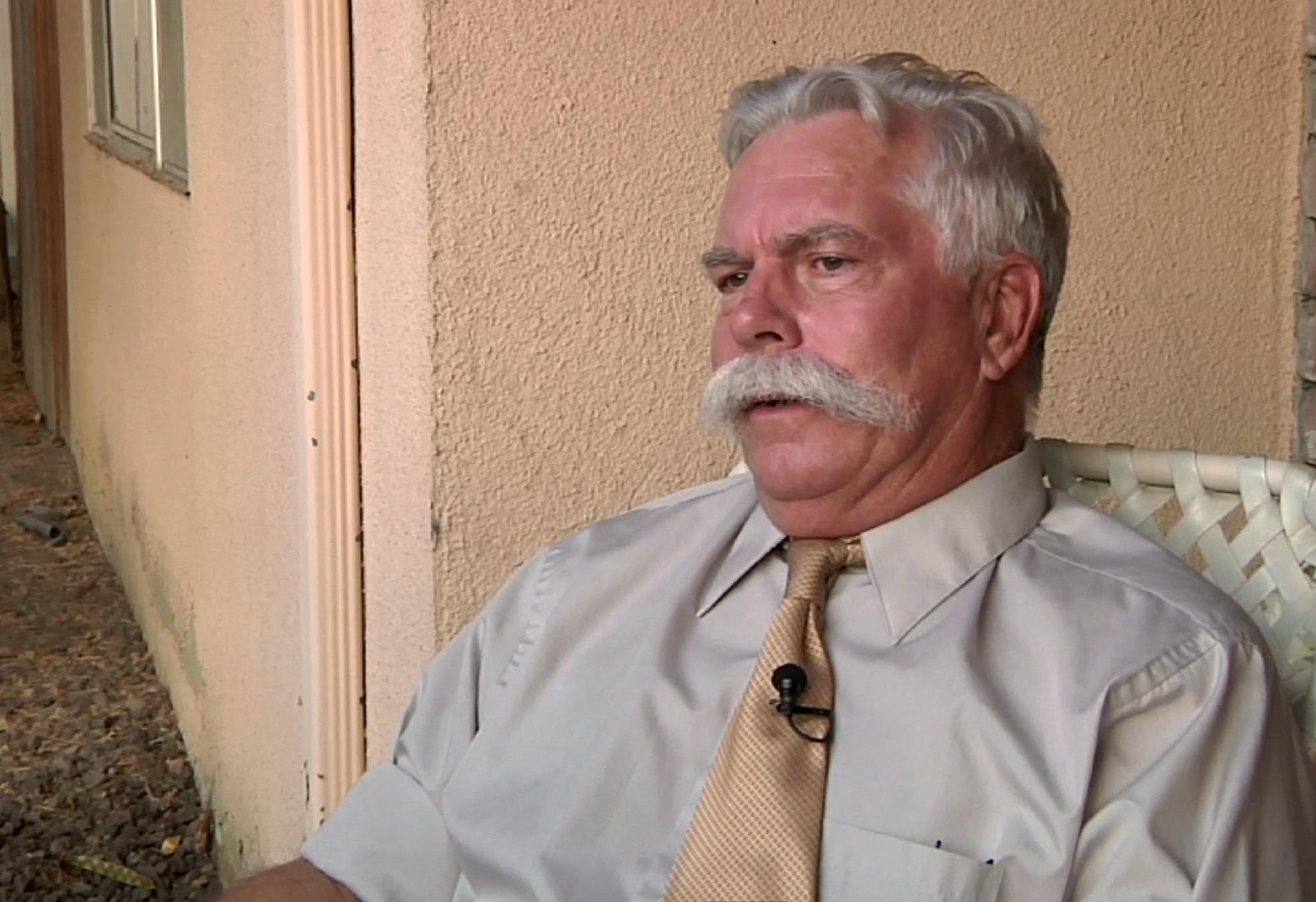 "In this frame grab from a video made on Wednesday, Sept. 12, 2012, Steve Klein, an insurance agent and Christian activist involved in ""Innocence of Muslims,"" a film denigrating Islam and the Prophet Muhammad that sparked outrage in the Middle East, speaks during an interview at his office in Hemet, Calif. (AP Photo/Gillian Flaccus)"