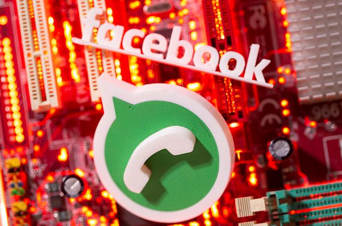 3D printed Whatsapp and Facebook logos are placed on a computer motherboard in this illustration taken January 21, 2021. REUTERS/Dado Ruvic/Illustration