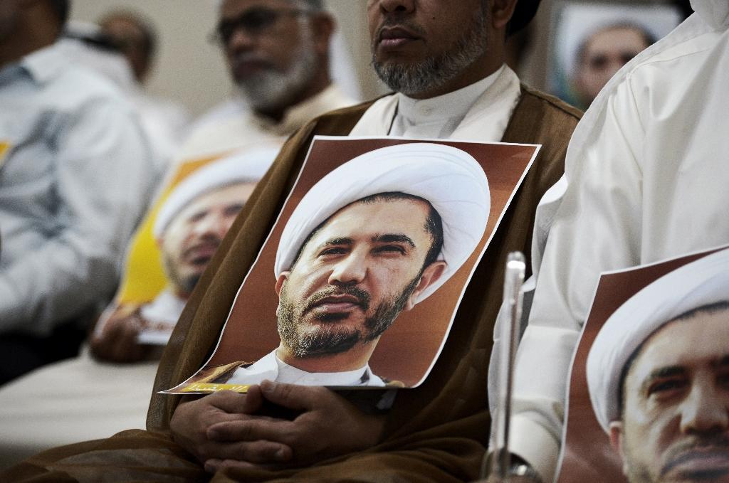 A Bahraini man holds a picture of Sheikh Ali Salman, head of the Shiite opposition movement Al-Wefaq, during a protest on May 29, 2016 against his arrest (AFP Photo/MOHAMMED AL-SHAIKH)