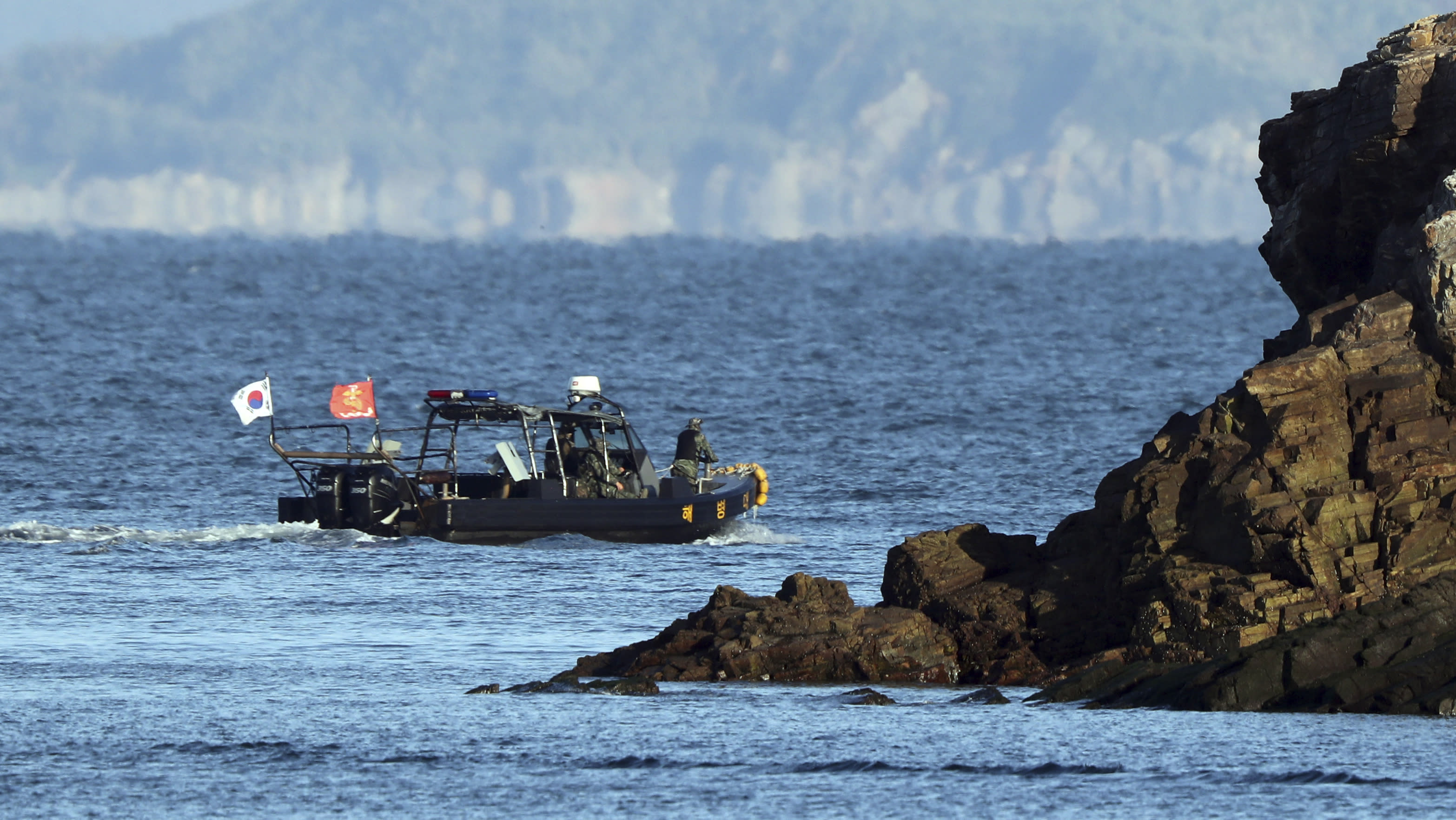 FILE - In this Sept. 27, 2020 file photo, a South Korean marine boat patrols near Yeonpyeong island, South Korea. South Korean President Moon Jae-in has apologized for the first time for the killing of a man who was shot by North Korean troops last week, saying his government failed in its responsibility to safeguard a citizen. The shooting triggered outrage that Seoul apparently wasted hours to rescue the man before his death. (Baek Seung-ryul/Yonhap via AP, File)