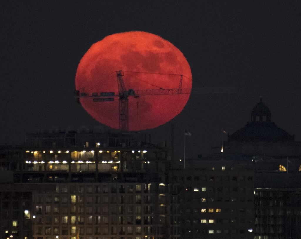 A supermoon rises over Washington on December 3, 2017 in this handout photo provided by NASA