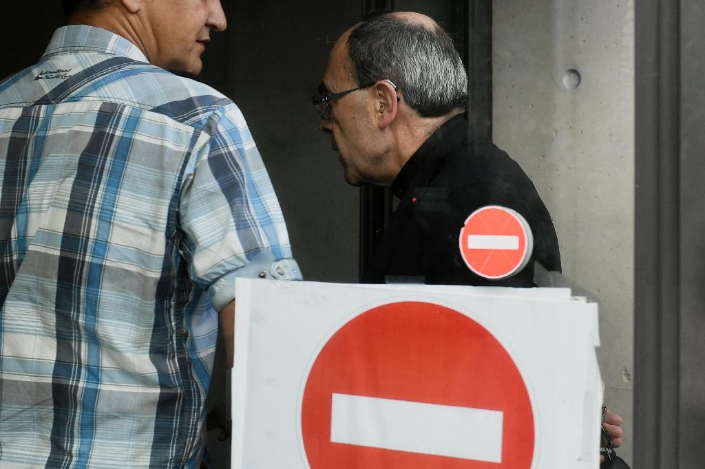 French Cardinal Philippe Barbarin, the under-fire Archbishop of Lyon suspected of covering up for a paedophile priest, arrives for questioning at a police station in Lyon, on June 8, 2016 (AFP Photo/Jeff Pachoud)