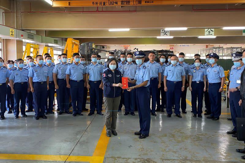 Taiwan's President Tsai Ing-wen visits an Air Force maintenance centre at the Gangshan air base in Kaohsiung, Taiwan