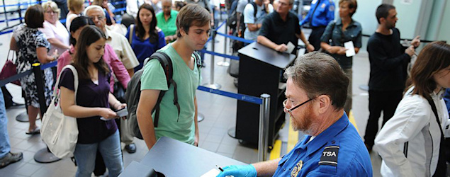 A TSA agent checks IDs at LAX. (Los Angeles Times)