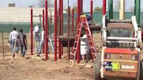 Kids help build their peers a new playground