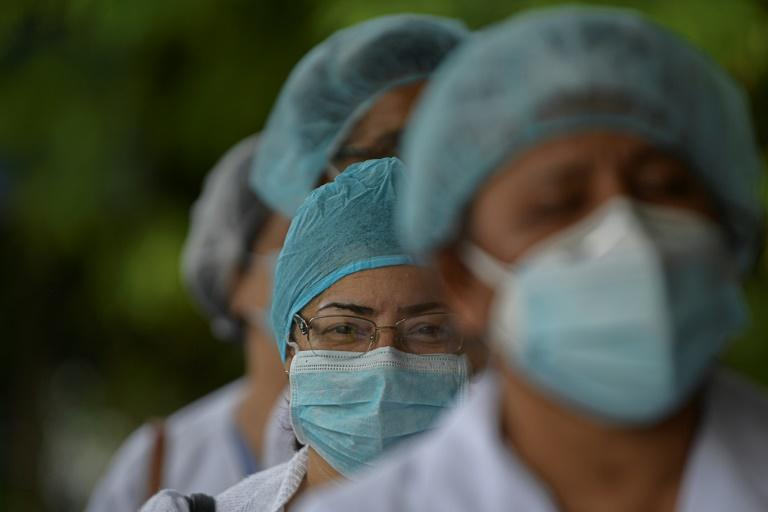 Health workers protest for lack of medical supplies at the Dr Arnulfo Arias Madrid hospital complex in Panama City, on July 16, 2020, as Panama exceeds 50,000 cases of COVID-19 (AFP Photo/Luis ACOSTA)