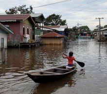 In pictures: Rising Amazon rivers flood Covid-hit areas in Brazil