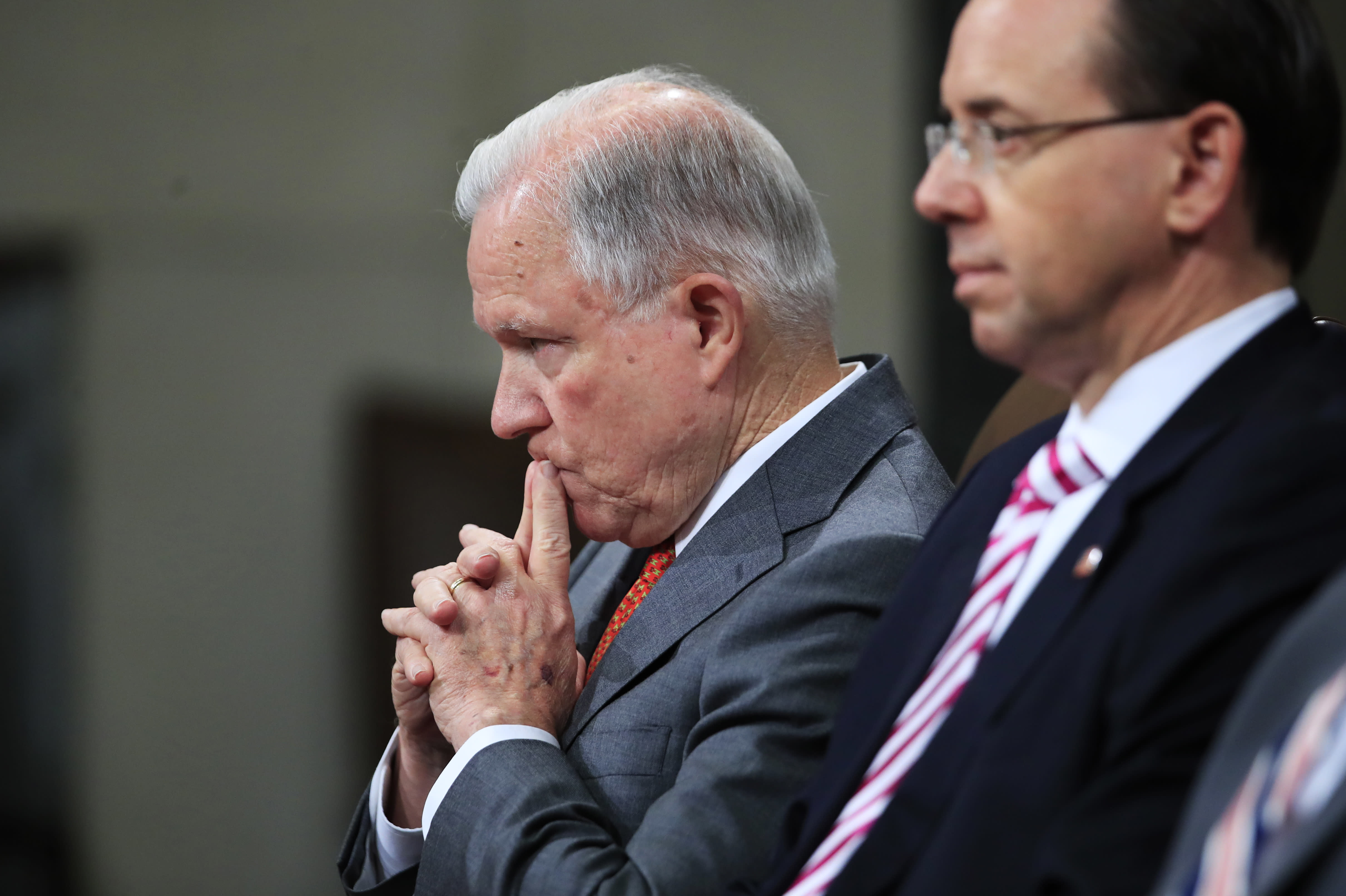 "Attorney General Jeff Sessions, left, and Deputy Attorney General Rod Rosenstein, listen to remarks during a Religious Liberty Summit at the Department of Justice, Monday, July 30, 2018. Sessions says there's a ""dangerous movement"" to erode protections for Americans to worship and believe as they choose. (AP Photo/Manuel Balce Ceneta)"