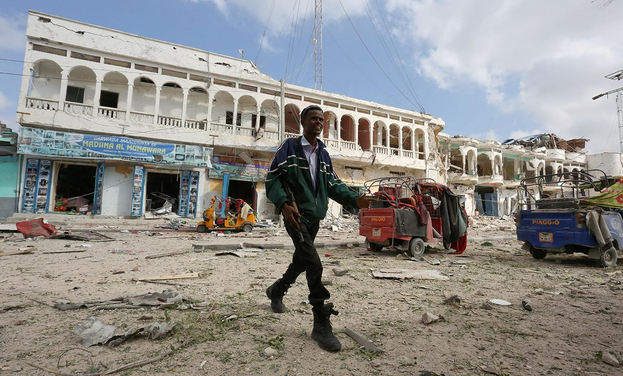 P A Somali Government Solr Walks Near The Scene Of An Explosion In Front