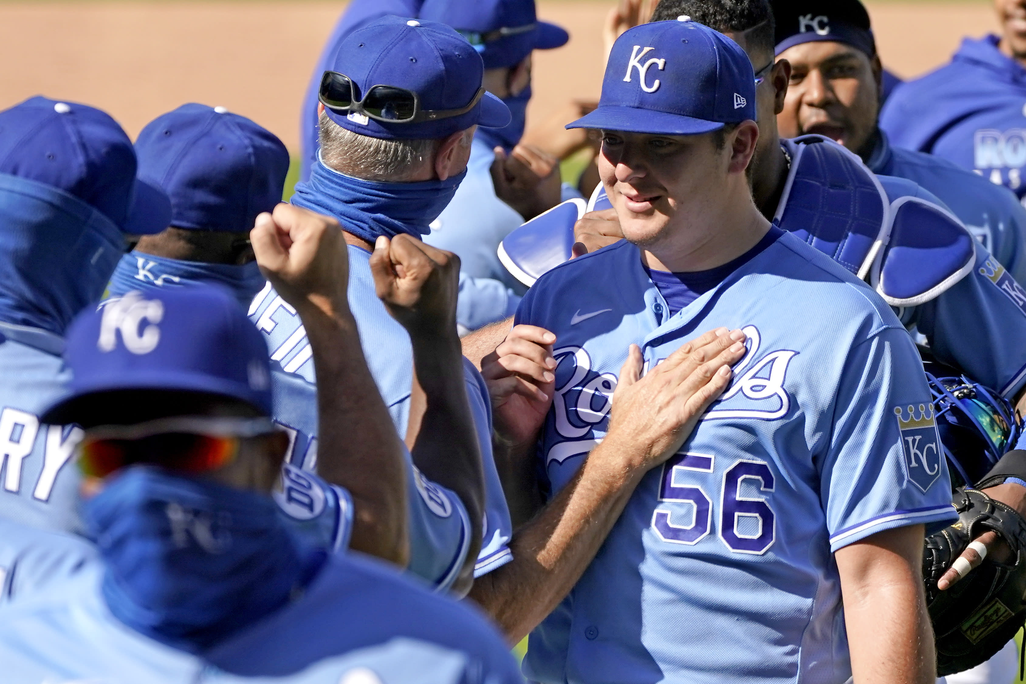 Kansas City Royals starting pitcher Brad Keller (56) celebrates with teammates after their baseball game against the Pittsburgh Pirates Sunday, Sept. 13, 2020, in Kansas City, Mo. Keller pitched a complete game and shut out the Pirates. (AP Photo/Charlie Riedel)