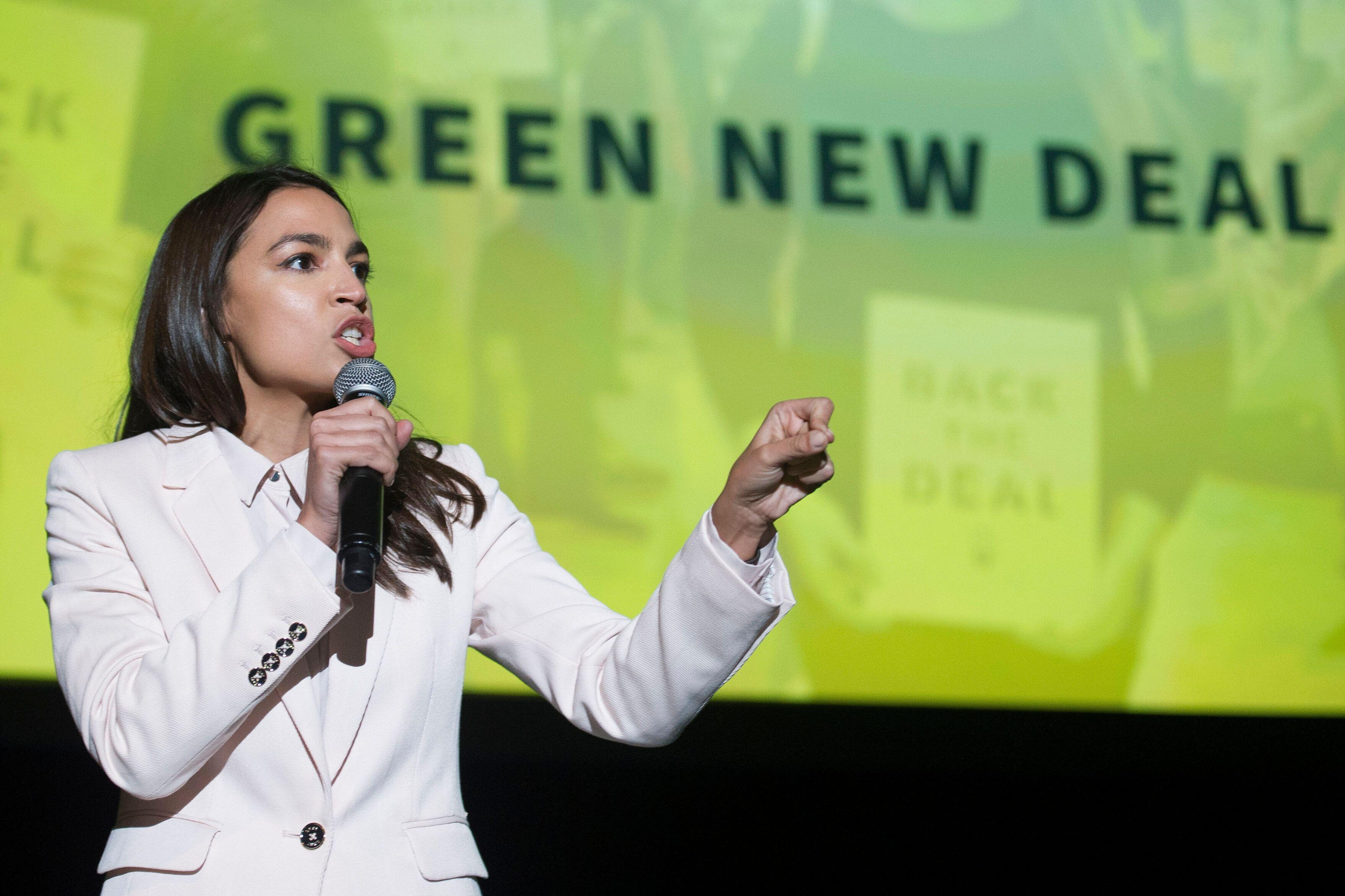 AOC, at Green New Deal rally, puts Joe Biden and other Democratic climate moderates on notice