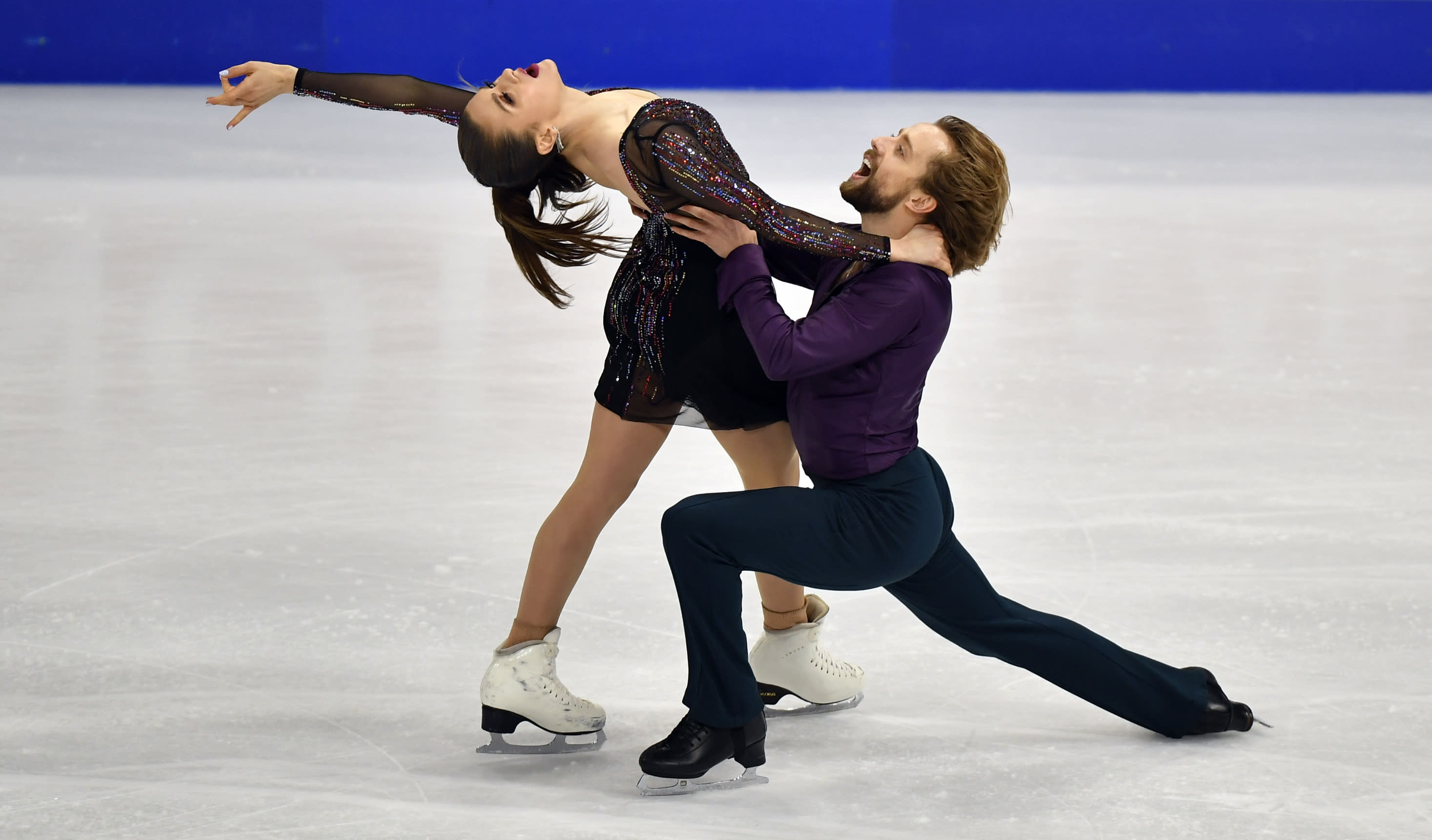 Kaitlin Hawayek and Jean-Luc Baker of the USA perform during the Ice Dance - Rhythm Dance at the Figure Skating World Championships in Stockholm, Sweden, Friday, March 26, 2021. (AP Photo/Martin Meissner)
