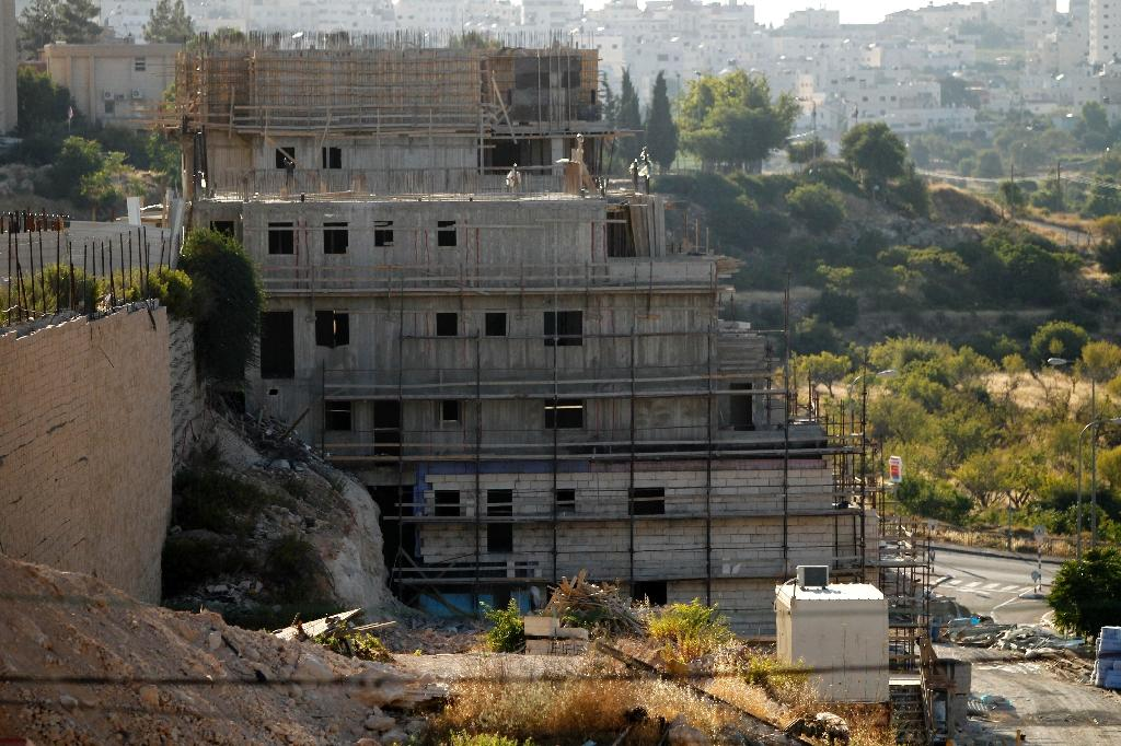 Buildings under construction in the Kiryat Arba Jewish settlement on the outskirts of the Palestinian flashpoint city
