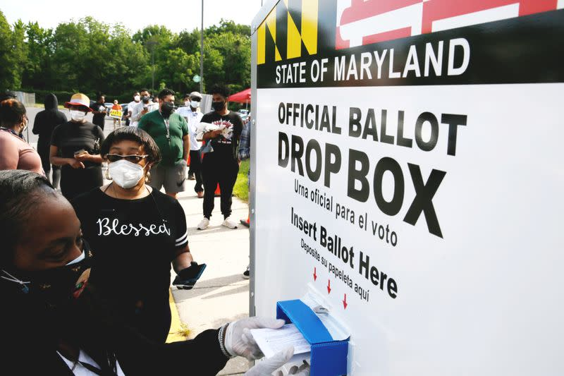 FILE PHOTO: Voters go to the polls to vote in U.S. presidential primary election in College Park, Maryland