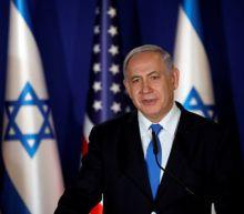 Israeli PM Netanyahu says he will sue political rivals for libel