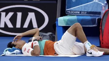 Nishikori injury hands Djokovic easy passage to Australian Open semi-finals