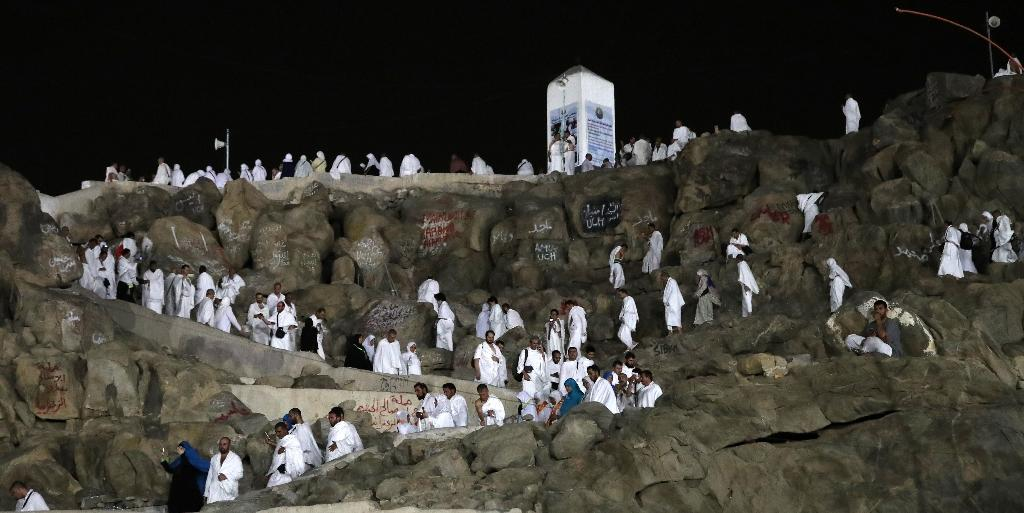 Muslim pilgrims walk and pray on Mount Arafat, also known as Jabal al-Rahma (Mount of Mercy), southeast of the Saudi holy city of Mecca, on the eve of Arafat Day which is the climax of the Hajj pilgrimage on August 30, 2017 (AFP Photo/KARIM SAHIB)