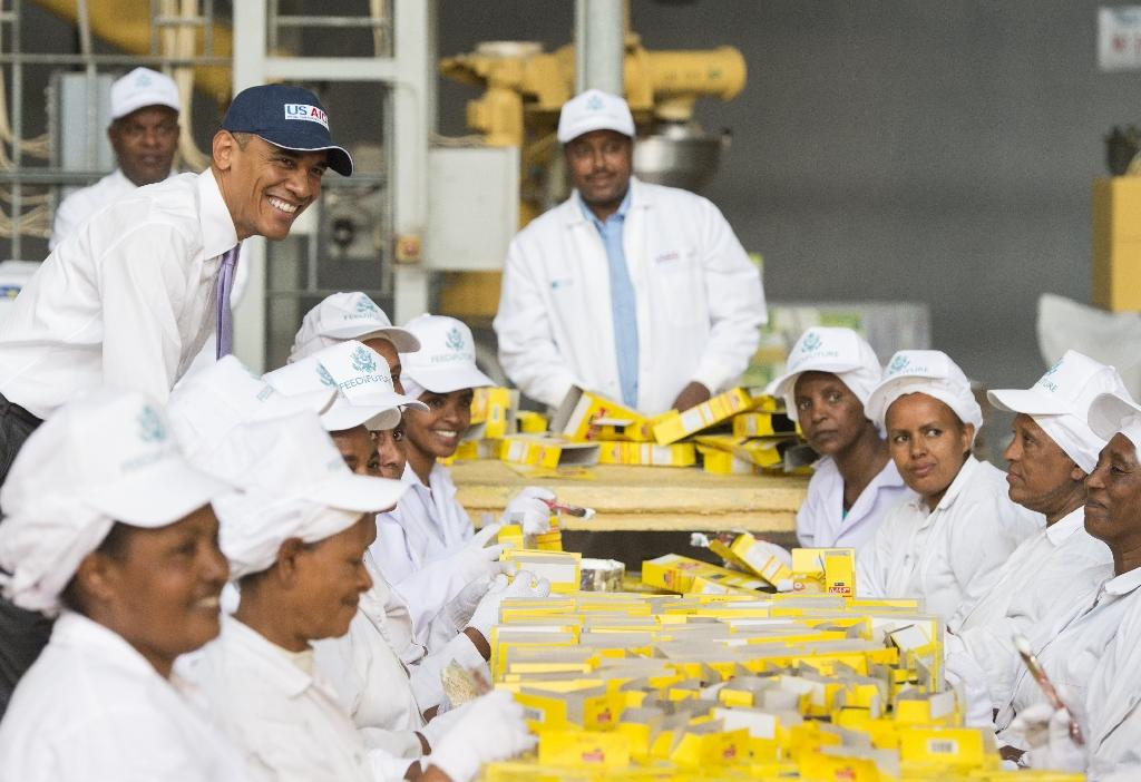 US President Barack Obama (top left) visits the Faffa Food factory, producing low-cost and high-protein foods, in Addis Ababa, on July 28, 2015 (AFP Photo/Saul Loeb)