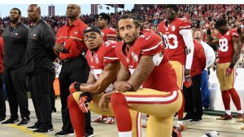 Ban NFL players who kneel in protest for a full season, Donald Trump says