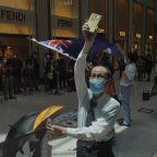 Hong Kong blocks Tiananmen vigil; rush on for UK passports