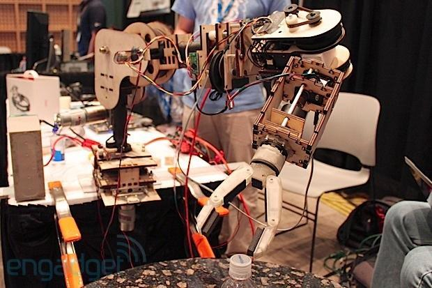 Columbia University's low-cost robotic arm is controlled by facial muscles, we go face-on (video)