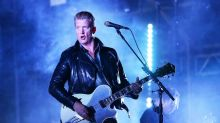 'I messed up': Josh Homme makes emotional apology after kicking female photographer during gig