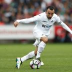 Swansea captain Britton signs new deal