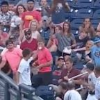Young College World Series fan barehands two foul balls down right field line in same game
