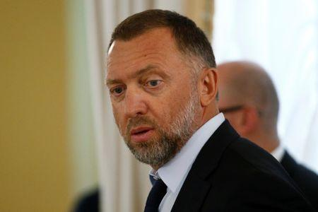 FILE PHOTO: Oleg Deripaska looks on before a meeting of Russian President Vladimir Putin and Turkish President Tayyip Erdogan with Russian and Turkish entrepreneurs at the Konstantinovsky Palace in St. Petersburg, Russia, August 9, 2016. REUTERS/Sergei Karpukhi