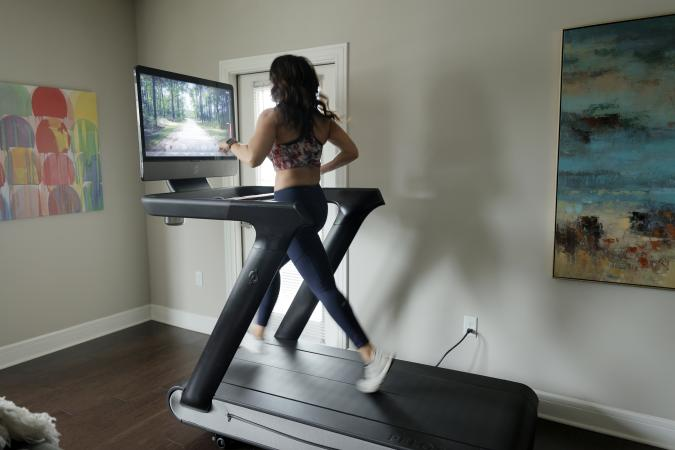 WILLIAMSTOWN, NEW JERSEY - MAY 24: Liza Lecher works out on her Peloton Tread+ treadmill on May 24, 2021 in Williamstown, New Jersey. Earlier this month, Peloton recalled its Tread and Tread+ treadmills due to multiple injuries and the death of a child, after initially resisting a U.S. safety agency's warning about the machines. (Photo by Michael Loccisano/Getty Images)