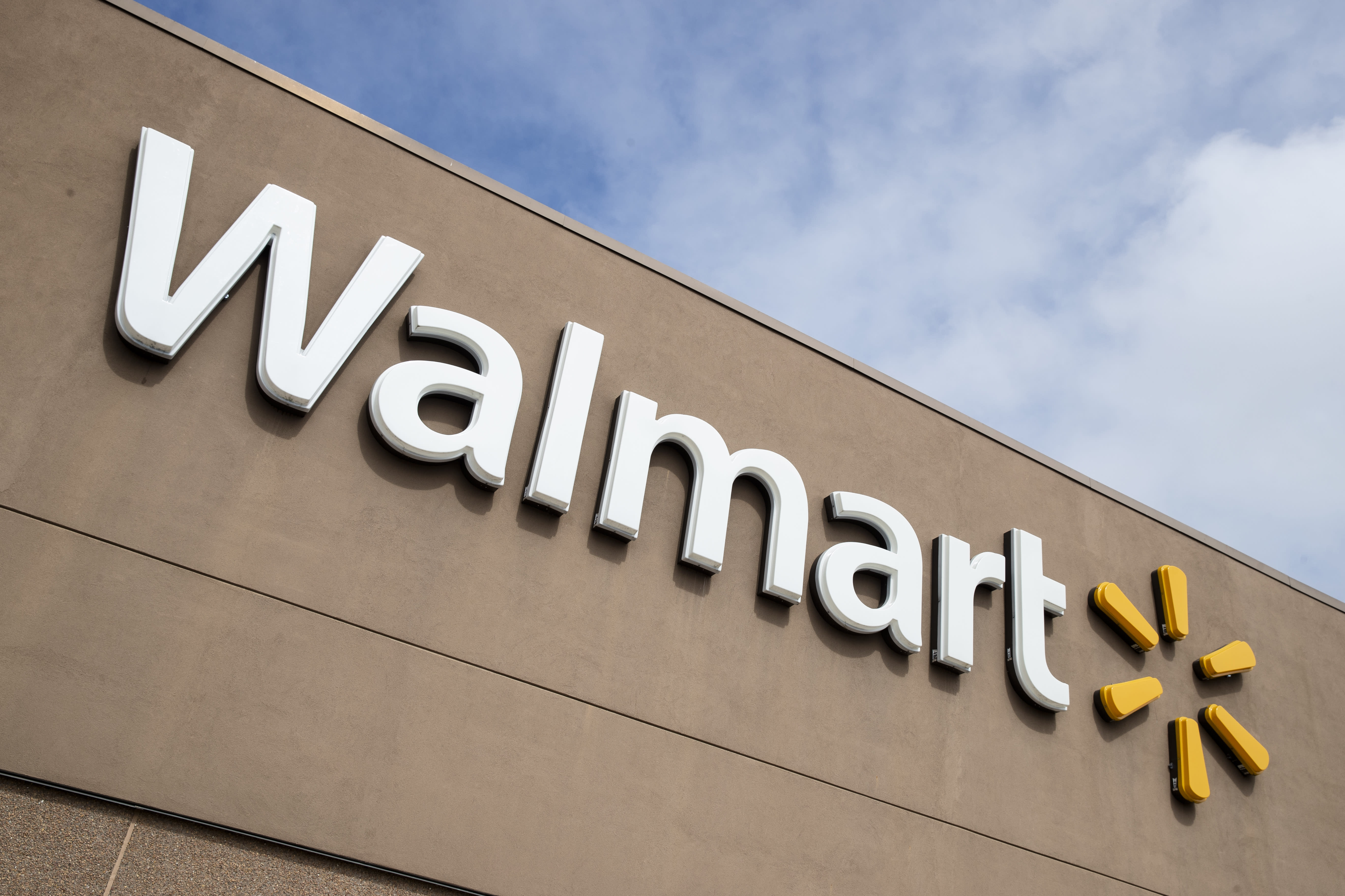 FILE - This Tuesday, March 17, 2020 file photo shows a Walmart in Warrington, Pa. A growing number of U.S. companies are pledging to give workers time off to vote in the presidential election this November, an effort that's gaining steam despite the government's reluctance to make Election Day a federal holiday. Walmart says it will give its 1.5 million U.S. workers up to three hours paid time off to vote.(AP Photo/Matt Rourke, File)