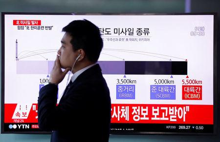 A man walks past a television broadcasting a news report on North Korea firing ballistic missiles, at a railway station in Seoul, South Korea, March 6, 2017. REUTERS/Kim Hong-Ji