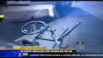 DUI suspect hospitalized after crashing bike into car
