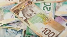 US dollar falls slightly against Canadian dollar to open the week