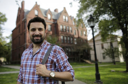 In this Thursday, Oct. 13, 2016 photo, Khaled Almilaji, who coordinated a campaign that vaccinated 1.4 million Syrian children and risked his life to provide medical care during the country's civil war, stands for a portrait on the campus of Brown University in Providence, R.I. Almilaji is now in the Ivy League, learning about how to rebuild Syria's health system when the war finally ends.