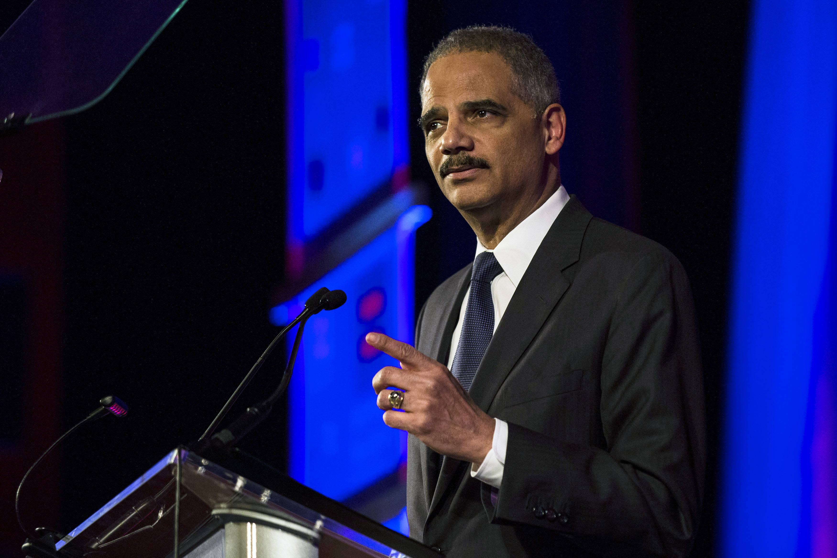 United States Attorney General Eric Holder speaks during the Human Rights Campaign's 13th annual Greater New York Gala in the Manhattan borough of New York, February 8, 2014. Holder plans widespread changes within the U.S. Justice Department to benefit same-sex married couples, such as recognizing a legal right for them not to testify against each other in civil and criminal cases. REUTERS/Keith Bedford (UNITED STATES - Tags: POLITICS CRIME LAW)