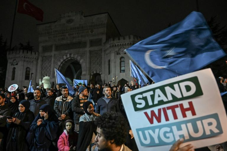 Rallies in support of Uighurs were held in Istanbul recently -- many Turks feel historic bonds with the Uighurs, either as fellow Muslims or as part of the same Turkic-speaking ethnic group (AFP Photo/Ozan KOSE)