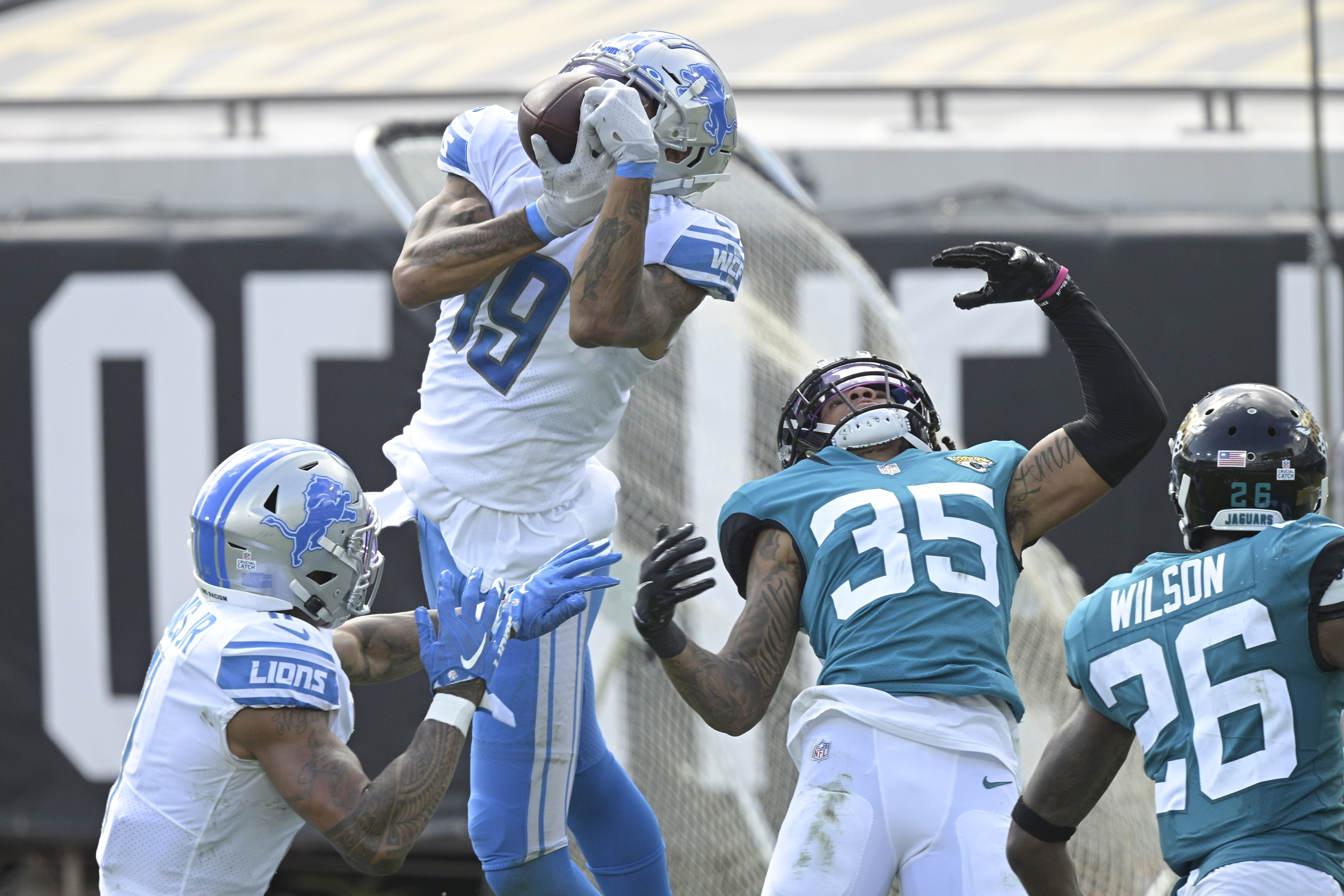 Detroit Lions wide receiver Kenny Golladay (19) makes a reception in front of Jacksonville Jaguars cornerback Sidney Jones (35) during the second half of an NFL football game, Sunday, Oct. 18, 2020, in Jacksonville, Fla. (AP Photo/Phelan M. Ebenhack)