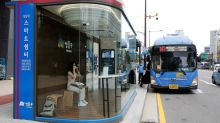 Keeps out rain and COVID-19, Seoul tries smart bus shelter to fight virus