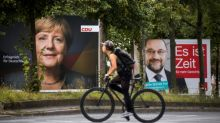 'Bring home the bacon,' Merkel tells voters on eve of poll