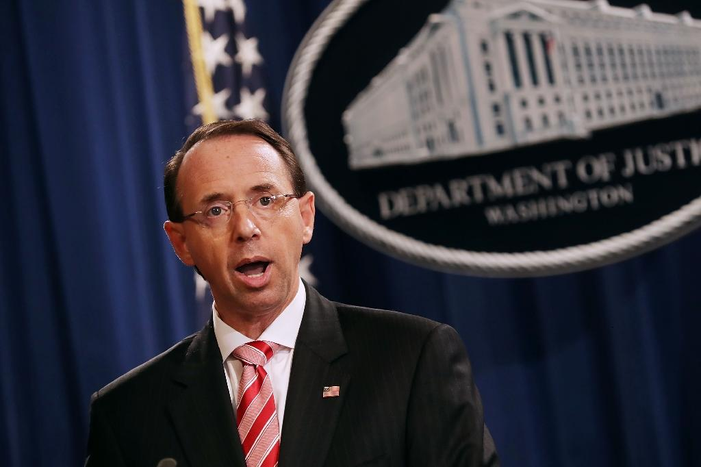 """US Deputy Attorney General Rod Rosenstein told reporters 12 Russian military officers were accused of """"conspiring to interfere with the 2016 presidential election"""" (AFP Photo/CHIP SOMODEVILLA)"""