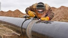 Get Paid While You Wait: 3 Top Dividend Stocks in Energy