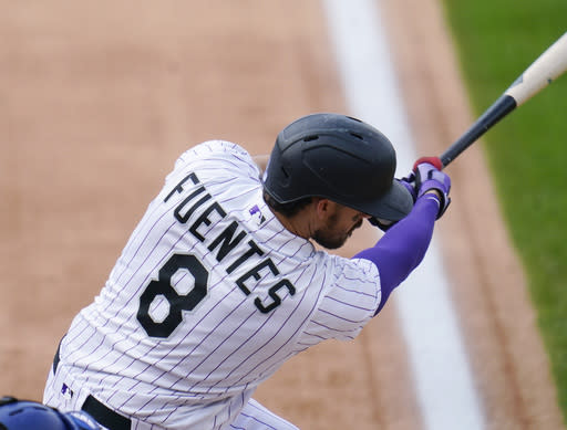 Colorado Rockies' Josh Fuentes connects for an RBI-single off Los Angeles Dodgers relief pitcher Blake Treinen in the sixth inning of a baseball game Sunday, Sept. 20, 2020, in Denver. (AP Photo/David Zalubowski)