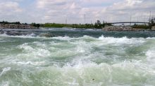 Mother and son rescued after raft hits safety boom and overturns on Bow River