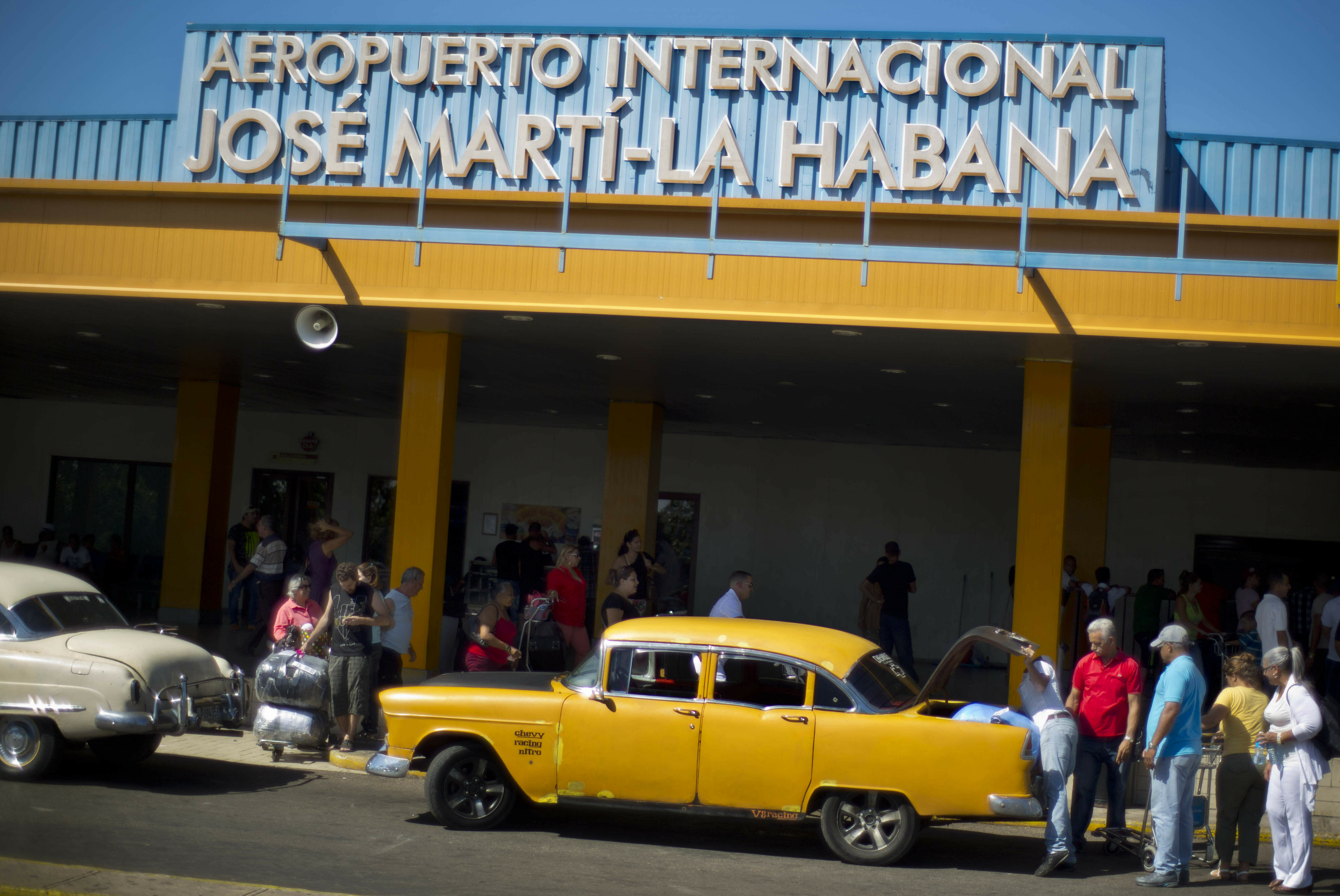 FILE - In this Sept. 1, 2014 file photo, people put their luggage in a private taxi as they arrive from the U.S. to the Jose Marti International Airport in Havana, Cuba. In 1958, the father of José Ramón López owned Cuba's main airport, its national airline and three small hotels. All were taken in Cuba's socialist revolution. Starting Thursday, they will be able to file lawsuits against European and American companies doing business on their former properties, thanks to the Trump administration's decision to activate a provision of the U.S. embargo on Cuba with the potential to affect foreign investment in Cuba for many years to come. (AP Photo/Ramon Espinosa, File)