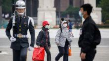 In Taiwan, anger at China over virus drives identity debate