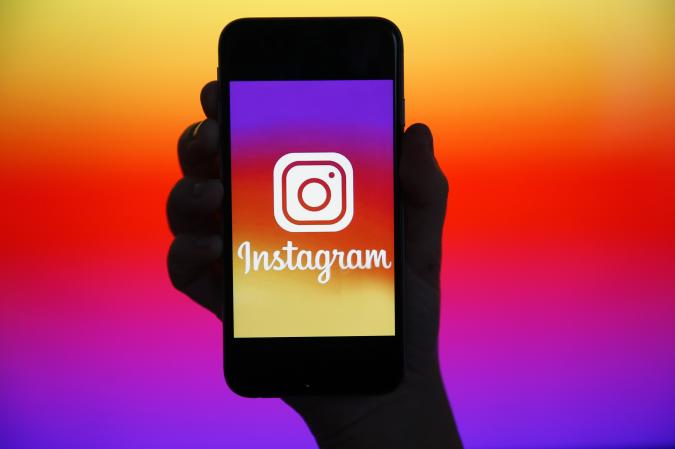 PARIS, FRANCE - DECEMBER 26: In this photo illustration, the Instagram logo is displayed on the screen of an iPhone on December 26, 2019 in Paris, France. Instagram is an application, a social network and a photo and video sharing service founded and launched in October 2010 by the American Kevin Systrom and the Brazilian Michel Mike Krieger. (Photo by Chesnot/Getty Images)