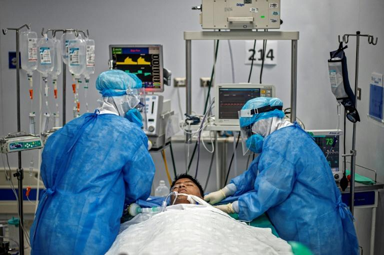 Nurses check the intubation of a COVID-19 patient in Lima, Peru, which has topped 10,000 deaths (AFP Photo/ERNESTO BENAVIDES)