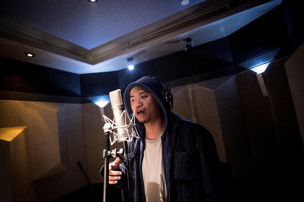 Rap slowly took root as artists infused beats with commentary on issues like China's growing economic inequalities (AFP Photo/Johannes EISELE)