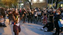 BLM activists march in support of protesters arrested overnight in Chicago